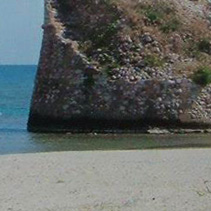 Old tower on the beach of Torre Pali